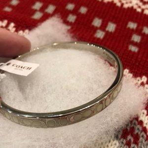 Beautiful Silver and Cream Coach bangle bracelet